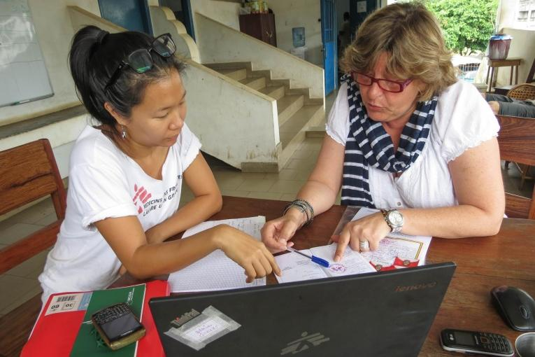 HR Coordinator Isabelle and Donka's Field Admin centre Marie go through a batch of applications, looking for an administrative assistant for the Ebola mission. Guinea. 2014.  © Laura Bianchi/MSF